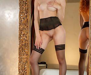 Flaming hot redhead Adel C..