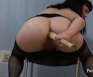 Natasha fucks her ass with a..