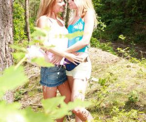 Lesbian teen Kim G teases her..