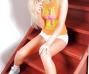 Blonde teen babe stripping to..