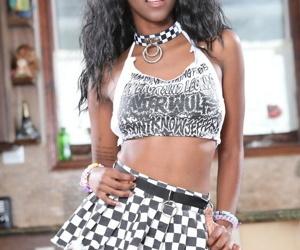 Ebony stunner Daizy Cooper strips..