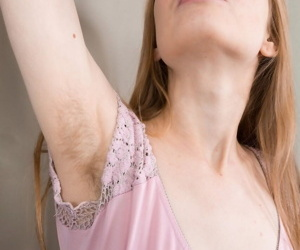 Amateur girl with hairy underarms..