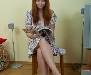 Pale redhead teen shows off her..