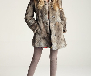 Nice teen girl takes off her fur..