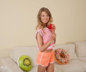 Innocent teen slides her shorts..