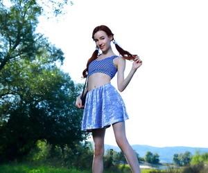 Young redhead Sherice pauses a..