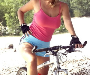 Blonde cyclist Carol G pauses to..