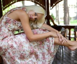 Hot blonde Alysha doffs her dress..