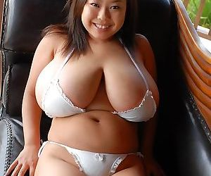 Japanese model with gigantic natural big tits in bikini -..
