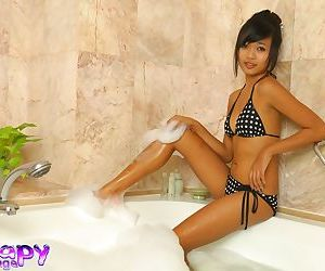 Hot young Asian teen lathers white cock for massage &..