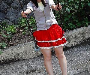 Smiley asian teen Miyuki Itou undressing and expposing her..