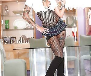 Naughty pornstar Bonnie Rotten struts around and flaunts..