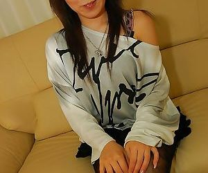 Smiley asian teen Ran Takeda undressing and exposing her..