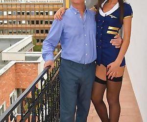 Hot attendant in uniform does steamy striptease before..