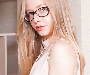 Young blonde Alexandra in glasses spreading hairy pussy..