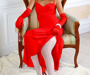 Beautiful elegant Jodie drops red gown to spread legs for..