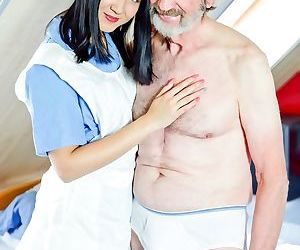 Dark haired nurse relieves her patient of his backed up..