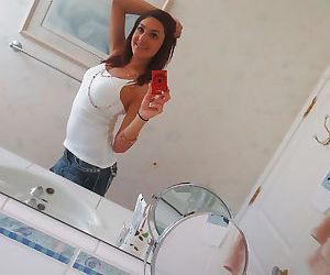 Nasty brunette slut Nikka taking couple of selfies in the..