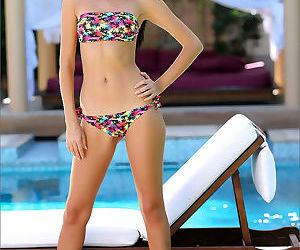 Nice teen girl with long legs removes her bikini for nude..