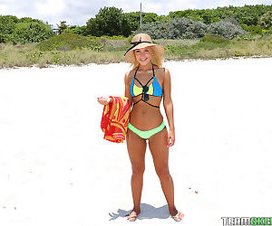 Amateur beach bunny Chanel Collins showing of phat thong..