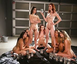The naked lesbian sex group gathers for its monthly pussy..