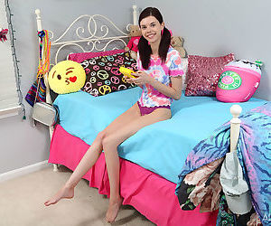 Skinny teen Audrey Grace in pigtails stuffs her young hole..