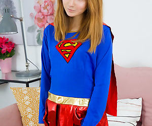 Petite young Apricot sheds her superhero costume spreading..