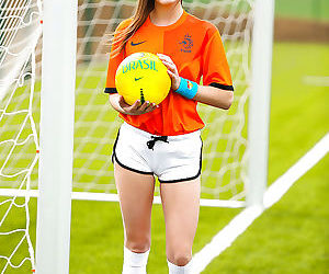 Lilly P is undressing her soccer uniform while on the..