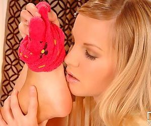 Sweet teen girls Lola N & Rose play foot games during..