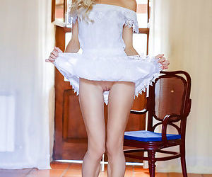 Cute blonde teen Nika N slips off her white dress for nude..