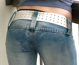 Amateur solo girl pulls down her jeans to show her ass in..
