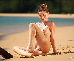 Thin brunette doffs her bikini to sun her tiny boobs &..