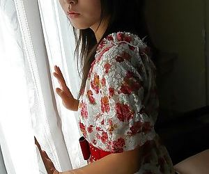 Asian teen Nao Miyazaki undressing and exposing her pussy..