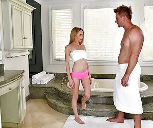 Young blonde cutie Angel Smalls using bare feet to jack..
