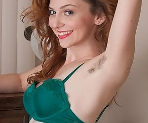 Redhead amateur Emma Evins peels off her nylons before..