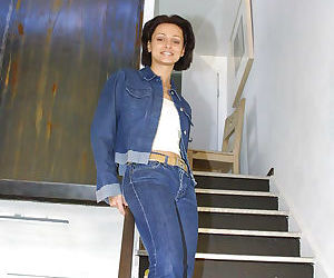 Big tit brunette in jeans Mona undressing and spreading..