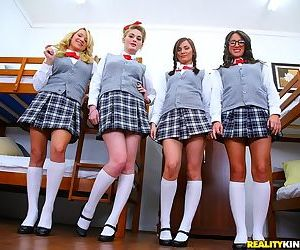 Naughty schoolgirls pull up plaid skirts and showing young..
