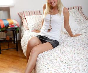 Innocent blonde teen Hailey rams a pink dildo up her asshole