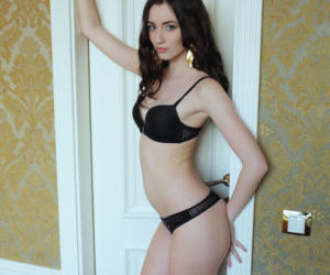 Bewitching Zsanett Tormay undressing her lithe body to..