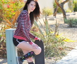 Brunette skater boards topless down the street & drops..