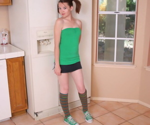 Cute redhead Kir in pigtails & knee socks strips down to..