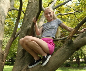 Cute blonde Emma Starletto shows off her flexibility while..