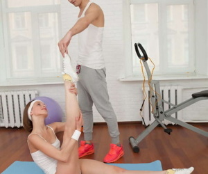 Flexible teen with a nice ass rides her personal trainer..
