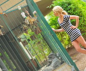 Cute blonde girl in tight dress bendsover to show hot ass..