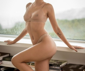 Beautiful petite centerfold babes show off their slender..