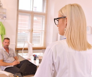 Striking blonde doctor Ria Sunn gives her patient the..