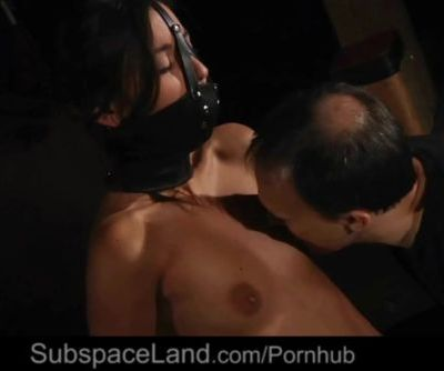 Dirty Eva garnished with muzzle gag and nipple clamps for doggie