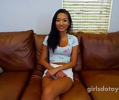 Sexy asian teen fucks herself with a big snow bunny on the kitchen table