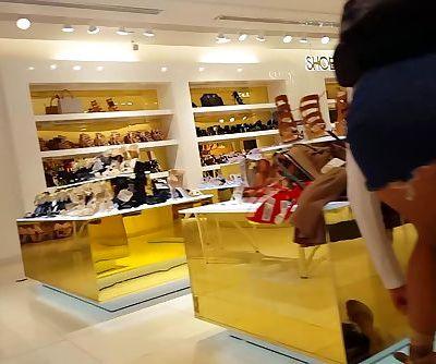 Candid voyeur teen skirt shoe shopping