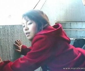 Cute Asian giving a hot outdoor..